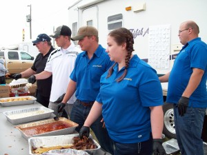 Enerplus employees serving lunch and participating at the annual Mandaree Pow Wow in 2013.
