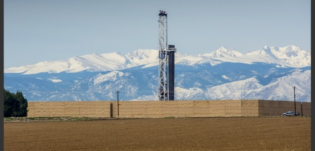 A drilling rig bores down into the energy-rich shale underneath Weld County. Sound walls, such as those encircling this rig, are erected around many drilling sites in Colorado to shield neighbors from industry operations.  Photo courtesy of the American Petroleum Institute.